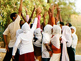 080123-Sudan-grp_reaching_hands.jpg
