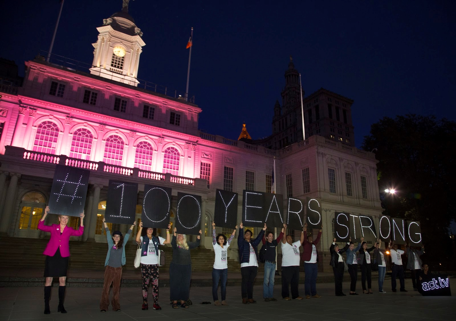 City_Hall_in_pink_for_100_Years_Strong.jpg
